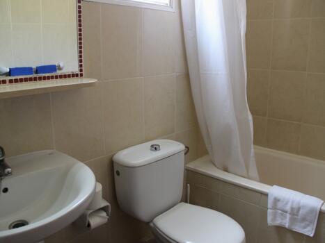 Foto del baño de Green Oasis Club
