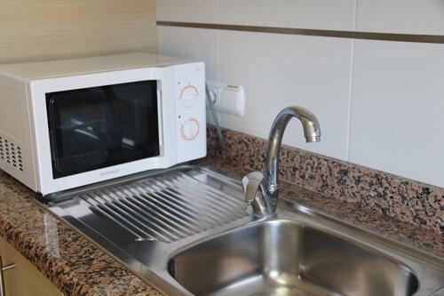 Foto di una camera da Apartamentos Larimar