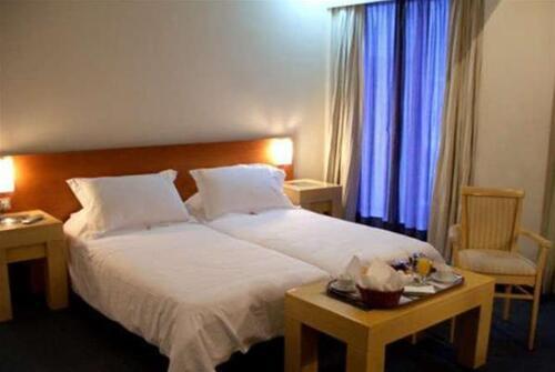 Foto de una habitación de Hotel Dorian Inn