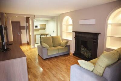 Foto de una habitación de Apartamentos Turisticos Cesaraugusta