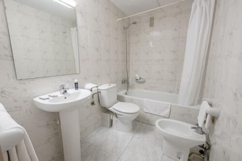 Foto del baño de Apartamentos California